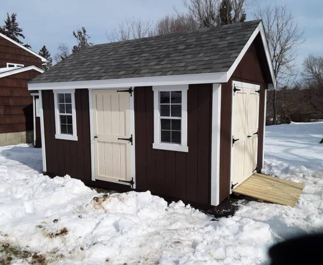 A-Frame Backyard Storage Shed with Brown T-111 Siding, White Trim, and Creme Doors