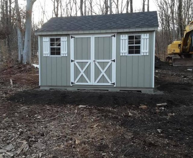 A-Frame Backyard Storage Shed with Green T-111 Siding, White Trim, and White Shutters