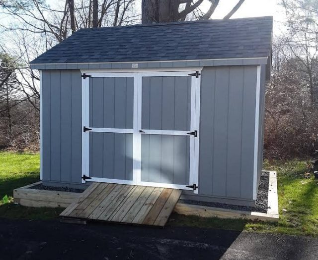 A-Frame Shed with Blue T-111 Siding, White Trim, and PT Wood Ramp