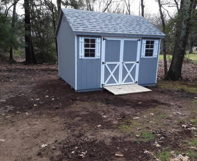A-Frame Shed with Blue T-111 Siding, White Trim, and White Shutters