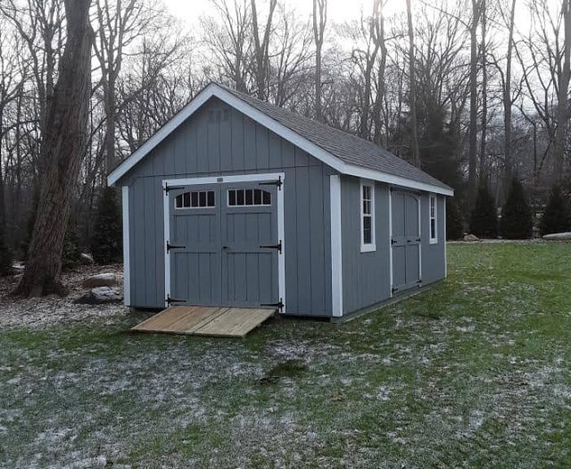 A-Frame Shed with Blue T-111 Siding, White Trim, and Windowed Double Door