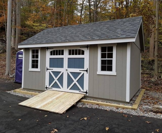 A-Frame Shed with Green T-111 Siding, White Trim and Blue Windowed Double Doors