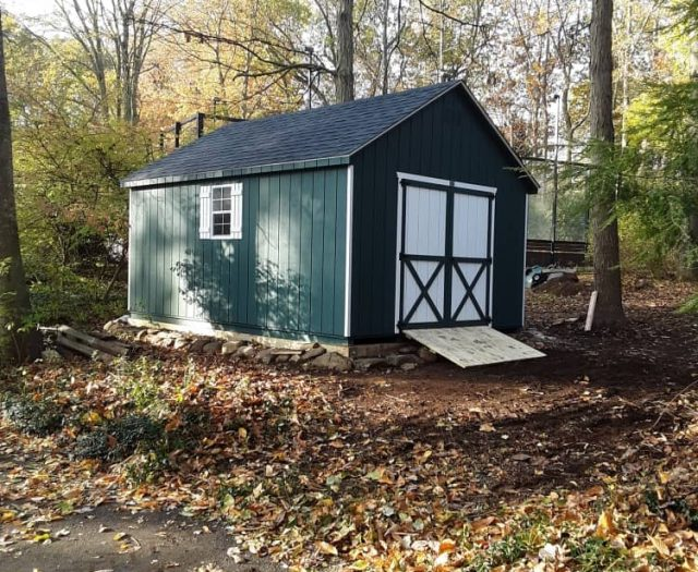 A-Frame Shed with Green T-111 Siding, White Trim, and White Double Doors