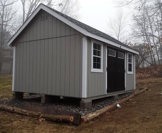 A-Frame Shed with Grey T-111 Siding, White Trim, and Windowed Black Double Doors
