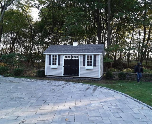 A-Frame Shed with White Vinyl Siding, Cupola and Black Double Doors