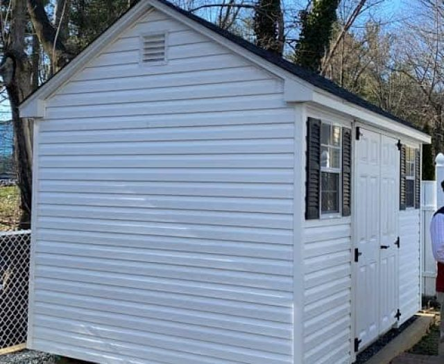 A-Frame Shed with White Vinyl Siding, White Trim, and Black Shutters