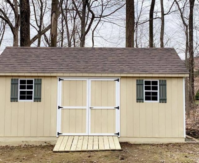A-Frame Shed with Yellow T-111 Siding, White Trim, and Green Shutters