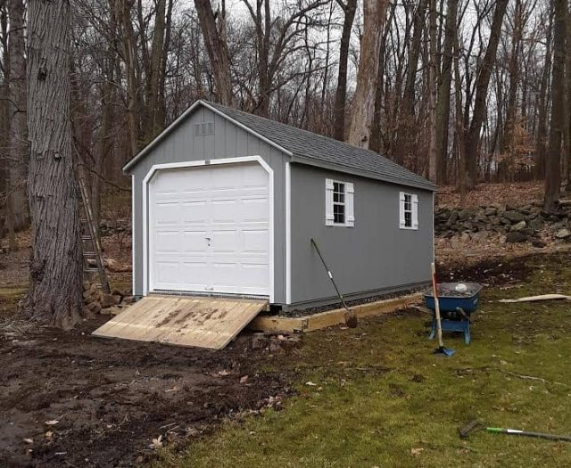 A-Frame Singe Car Garage with Gray T-111 Siding, White Shutters, and White Garage Door