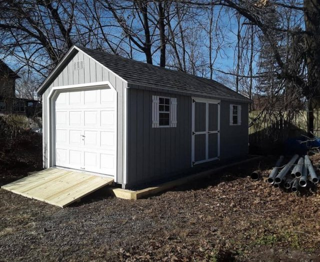 A-Frame Single Car Garage with Gray T-111 Siding, White Trim, and White Shutters