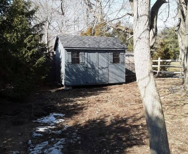 A-Frame Storage Shed with Blue Gray T-111 Siding, Trim, and Shutters