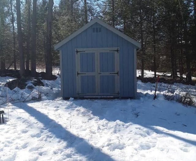 A- Frame Storage Shed with Blue T-111 Siding, Grey Trim, and Double Doors