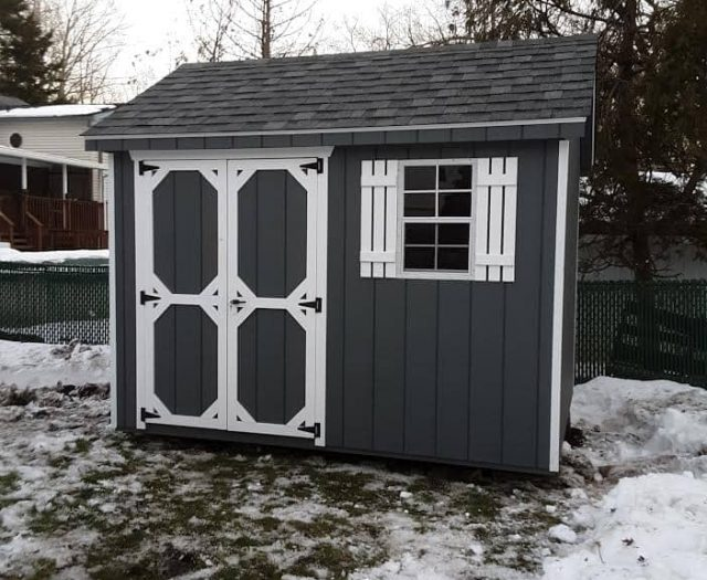 A-Frame Storage Shed with Dark Blue T-111 Siding, White Trim, and Shutters