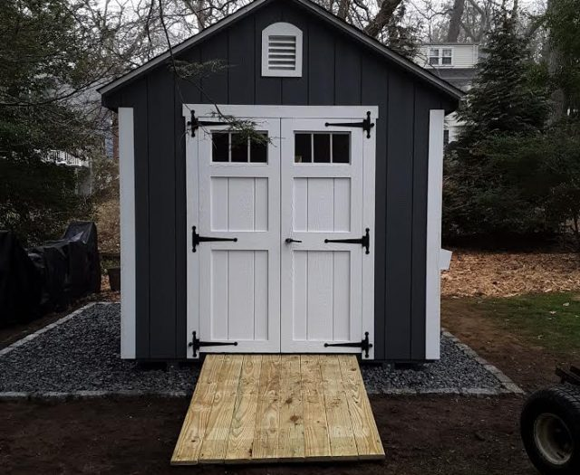 A-Frame Storage Shed with Dark Blue T-111 Siding, White Trim, and White Windowed Double Door