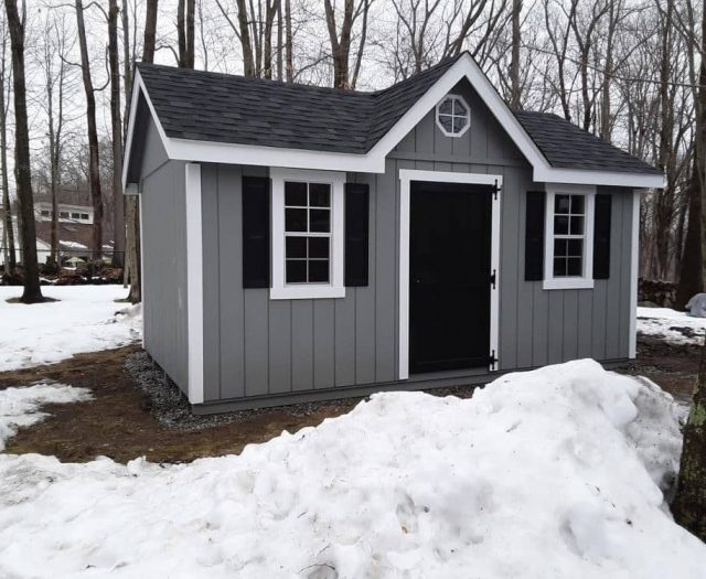 A-Frame Storage Shed with Gray T-111 Siding, Black Door, White Trim, and Black Shutters