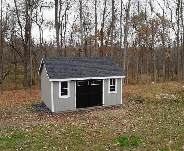 A-Frame Storage Shed with Grey T-111 Siding, White Trim, and Black Double Doors