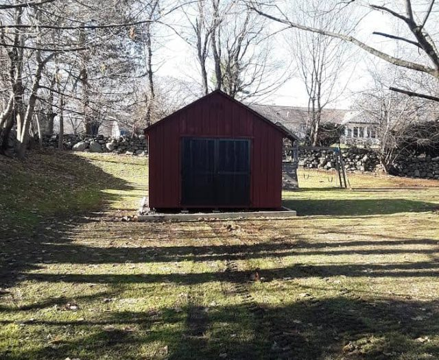 A- Frame Storage Shed with Red T-111 Siding, Red Trim, and Black Double Doors