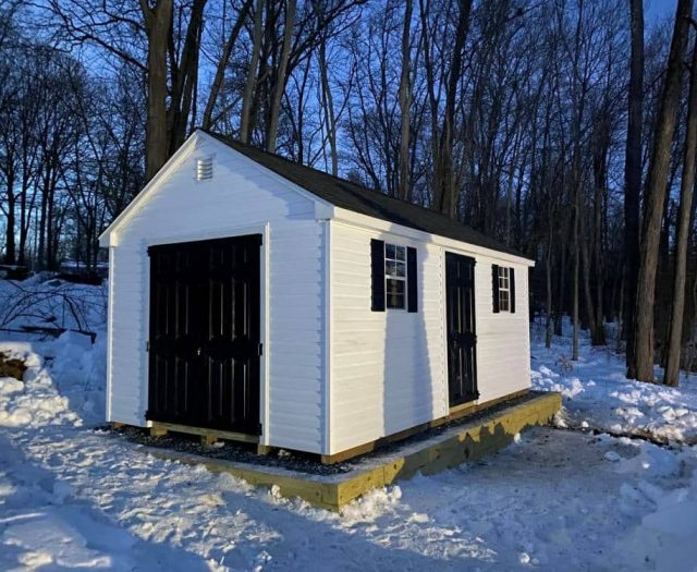 A-Frame Storage Shed with White Vinyl Siding, Black Doors, and Black Shingles