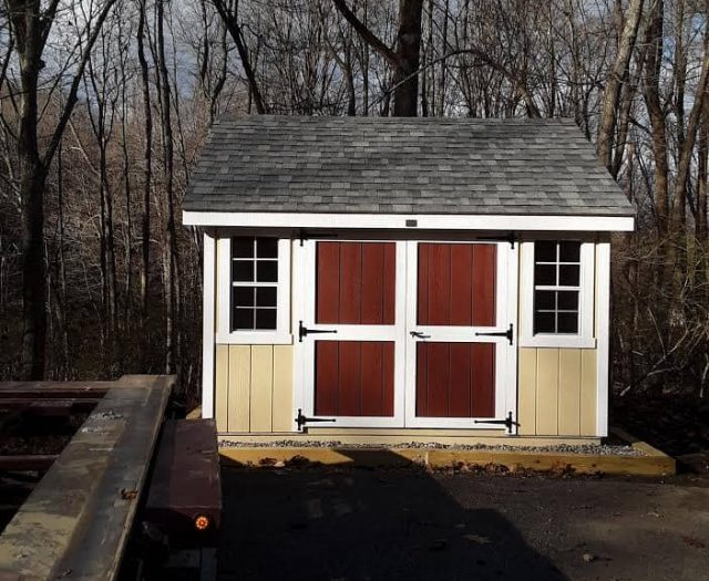 A-Frame Storage Shed with Yellow T-111 Siding, Red Double Door, and White Trim