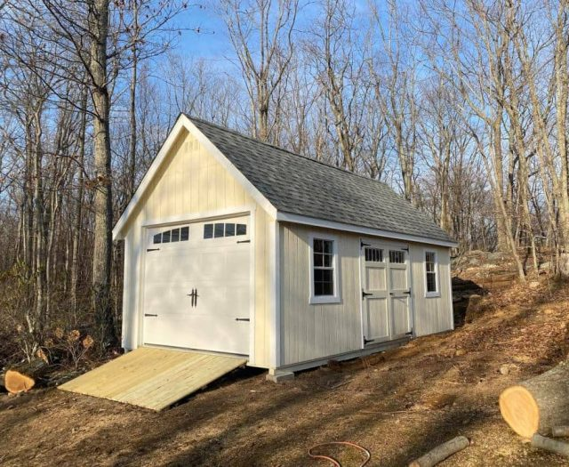 A-Frame Storage Shed with Yellow T-111 Siding, White Trim, and Garage Door
