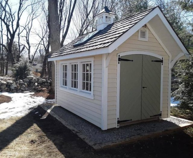 A-Frame Storage Shed with Yellow Vinyl Siding, Green Double Door, and Cupola
