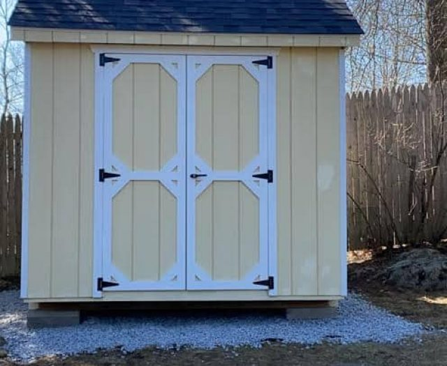 A-Frame Storage Shed with Yellow Wooden Siding, White Trim, and Cupola Weather Vane