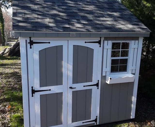 A-Frame with Gray T-111 Siding, White Trim, and White Shutters