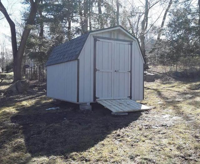 Barn Storage Shed with Beige T-111 Siding, Brown Trim, and PT Wood Ramp