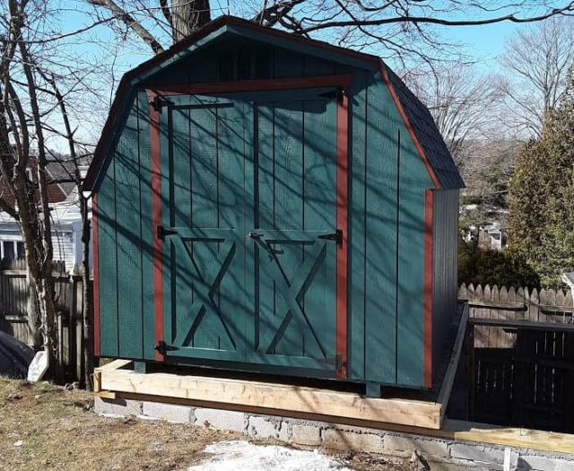 Barn Storage Shed with Blue Green T-111 Siding, Red Trim, and Double Doors
