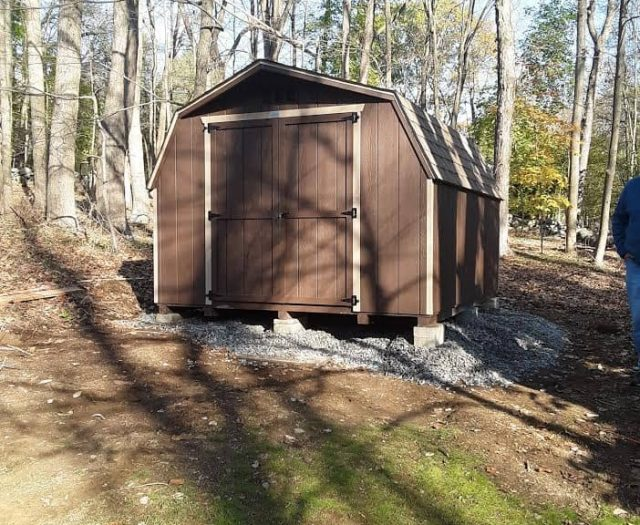 Barn Storage Shed with Dark Brown T-111 Siding, and Light Brown Trim