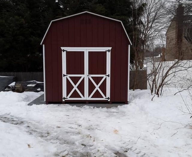 Barn Storage Shed with Red T-111 Siding, White Trim, and Double Doors