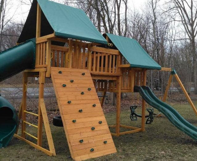 Fantasy Swing Set with Rock Wall, Horse Glider Swing, and Wave Slide