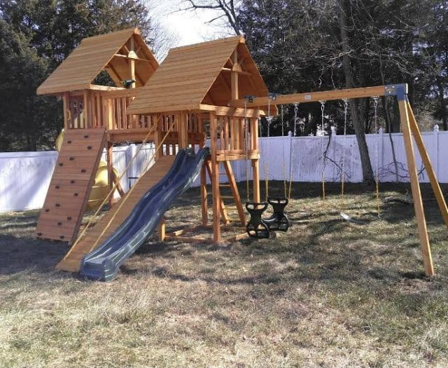 Fantasy Swing Set with Wood Roof, Horse Glider Swing, and Rock Wall