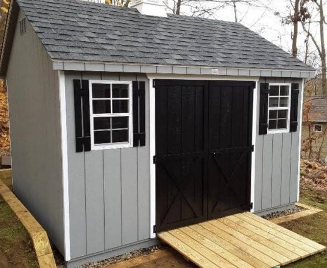 A- Frame Backyard Shed with Blueish Gray T-111 Siding, Cupola, and Black Double Doors