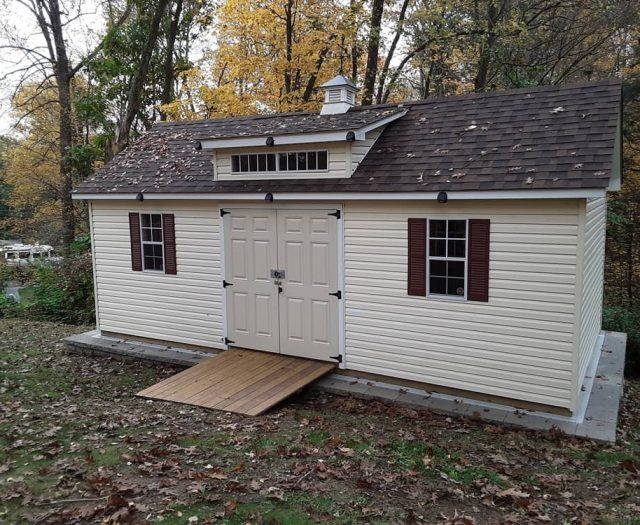 A- Frame Backyard Shed with Yellow Vinyl Siding, PT Ramp, and Weather Vane Copula