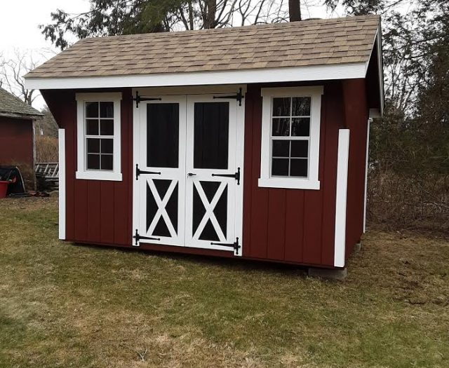 Quaker Storage Shed with Red T-111 Siding, White Trim, and Black Double Doors-min