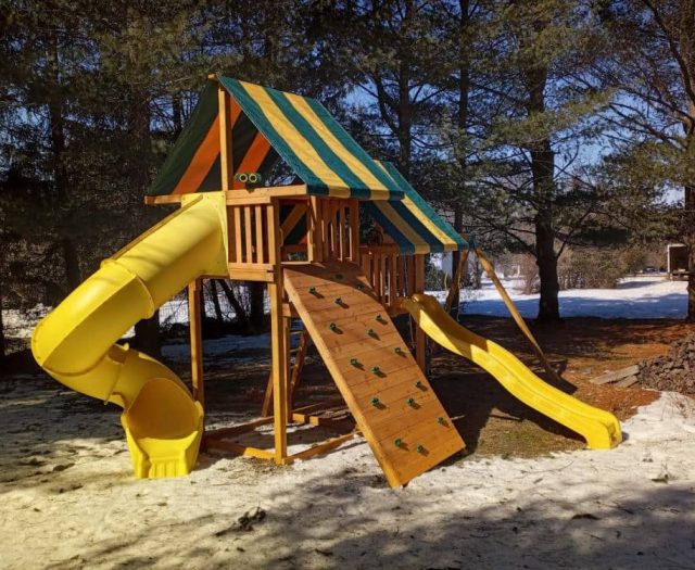 Sky Swing Set with Rock Wall, Spiral Slide, and Striped Tent Tops