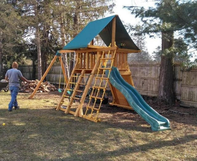 Supreme Swing Set with Green Tent Top, Sling Swing, and Rock Wall