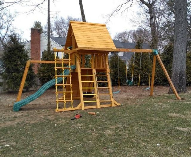 Supreme Swing Set with Monkey Bars, Ladder, and Wooden Roof