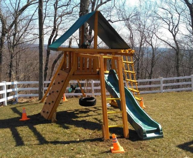 Supreme Swing Set with Tire Swing, Rock Wall, and Monkey Bars
