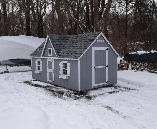 Victorian Style Kid's Playhouse with Blue T-111 Siding, White Trim, and White Flower Boxes