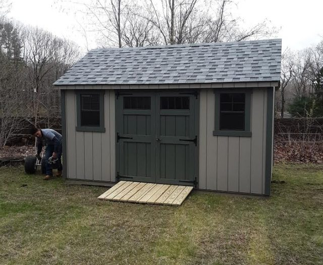 A-Frame Storage Shed with Gray T-111 Siding, Dark Green Double Doors and Trim