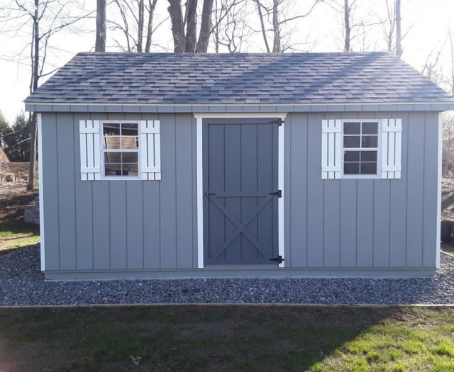 A-Frame Storage Shed with Light Blue T-111 Siding, White Shutters, and Dark Blue Door
