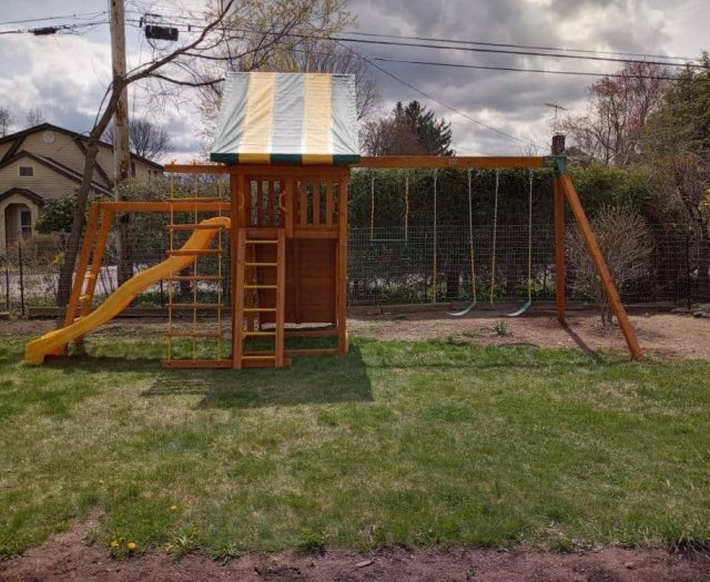 Dream Jungle Gym with Yellow Wave Slide, Monkey Bars, and Jacob's Ladder