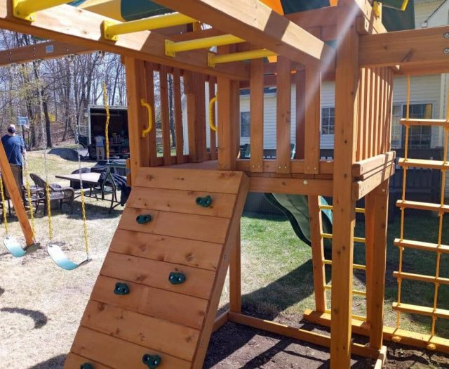 Dream Swing Set Close Up of Rock Wall and Monkey Bars