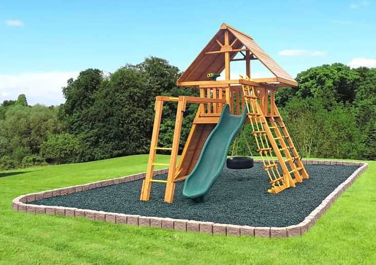 wooden playset with rubber mulch and flex border