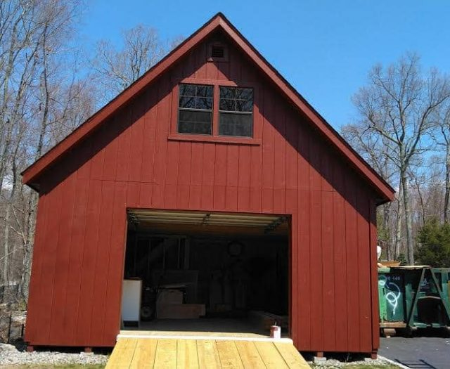 A-Frame Single Car Garage with Red T-111 Siding, Second Story, and Red Trim