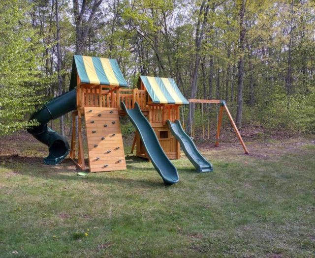Fantasy Swing Set with Bottom Clubhouse, Green Spiral Slide, and Rock Wall
