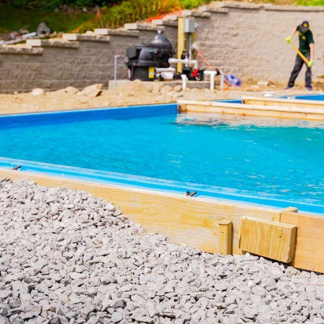 concrete patio installation around inground pool