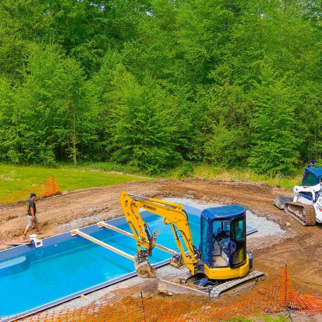 excavator working on fiberglass inground pool