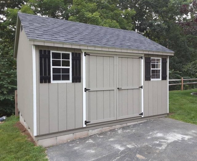 A-Frame Backyard Shed with Gray T-111 Siding, White Trim and Black Lattice Shutters